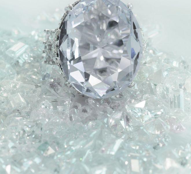 beautiful-large-diamond-engagement-wedding-ring-sitting-on-diamonds-scattered-background